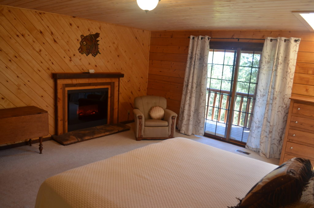 The master bedroom has an electric fireplace and private deck.