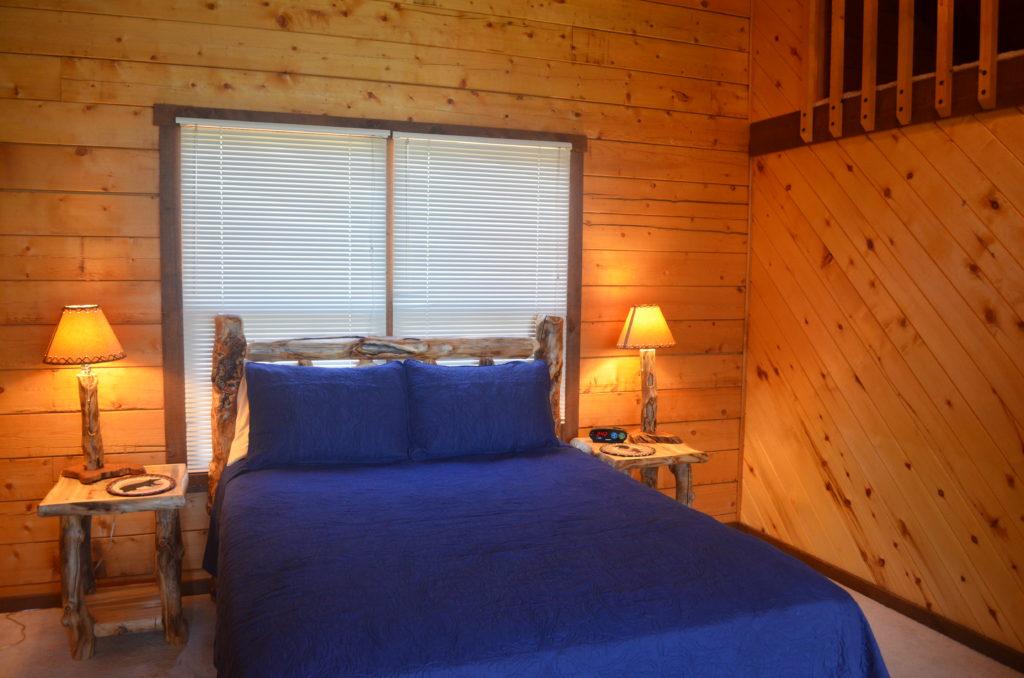 Loft bedroom with a queen bed.