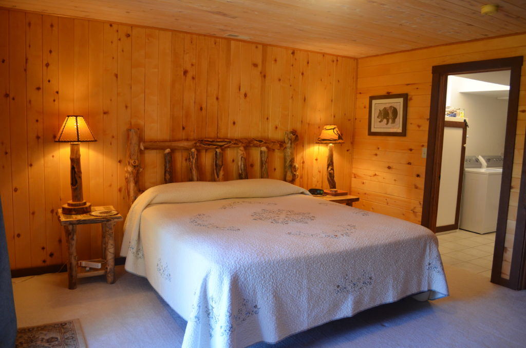 Downstairs bedroom has a king bed, en suite bath, and private outdoor access.