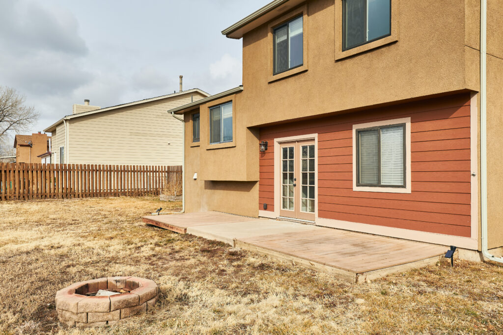 This home is spacious, inside and out with a great yard and views of Cheyenne Mountain!